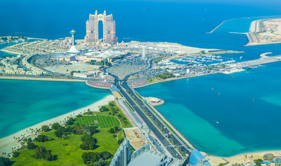 Bird's eye and aerial drone view of Abu Dhabi city from observation deck