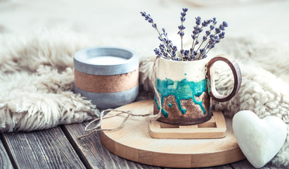 Cozy home composition on wooden background