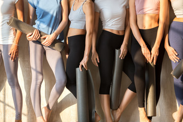 Legs of toned girls waiting for yoga session