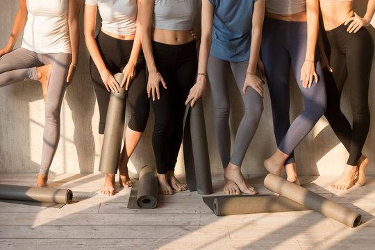 Toned female yogi in leggings waiting for yoga class