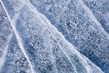Cracks in ice of Baikal lake. Winter texture