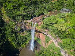 Aerial view on Chamarel waterfall, Mauritius island. Beautiful view of green tropical forest with high waterfall.