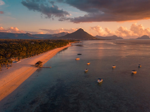 Aerial view of Flic and Flac beach in Mauritius, sunset light. Exotic beach sunset.