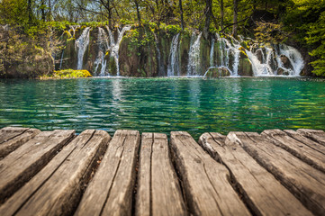 View of lovely cascades plunging in emerald pond, taken from the park boardwalk, Plitvice Lakes National Park, Croatia