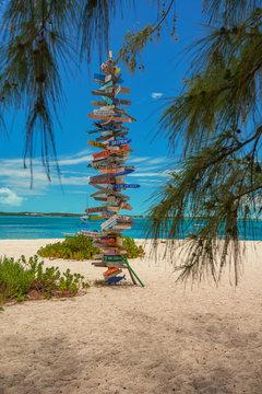 signpost on beautiful beach at stocking islands, Exuma, Bahamas