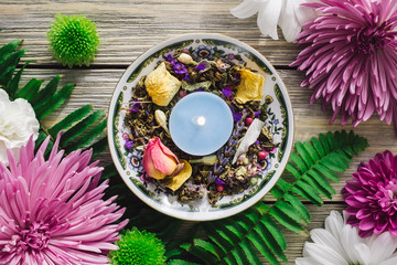Blue Candle with Herbs and Spring Flowers