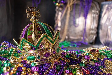mardi gras crown and beads in green, gold, and purple