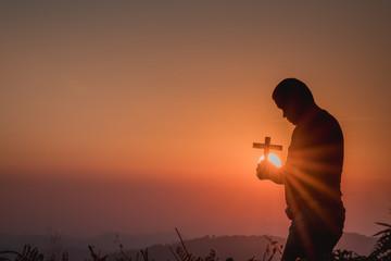The human hand holds cross a christian religion faith concept