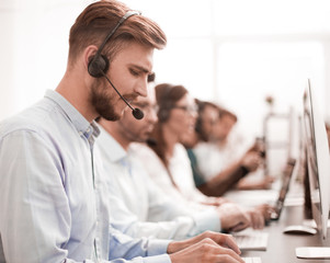 handsome man with a headset working in a call center