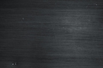 Brushed metal texture background. Scratched black stainless steel