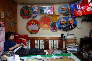 Images of the revolutionary icons Karl Marx and Vladimir Lenin are seen next to Vietnamese memorabilia at a shop in Hanoi