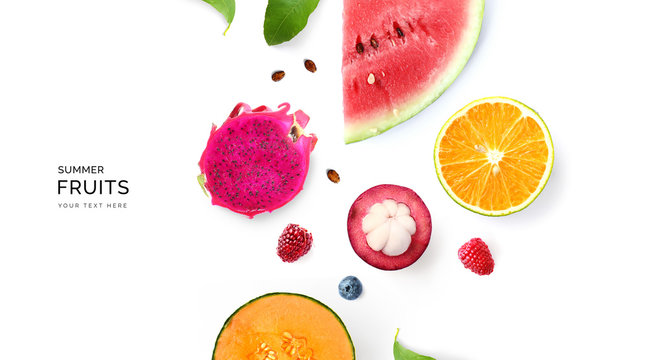 Creative layout made of summer fruits.  Tropical flat lay. Food concept. Melon, watermelon, mangosteen, dragonfruit and  loganberry on white background