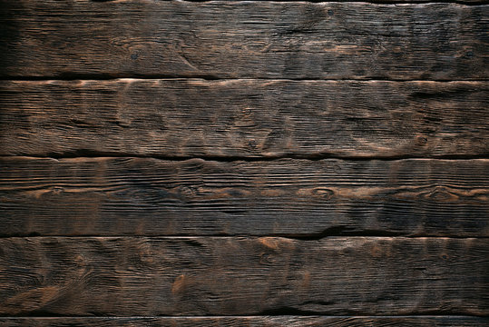 Aged wooden plank board texture background.