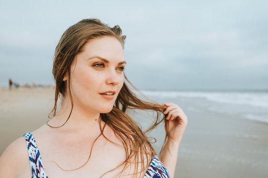 Blond woman standing on beach