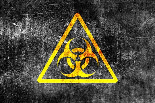 Biohazard sign on old grungy wall. Grunge biohazard symbol. Monochrome black and yellow illustration