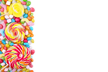 Colorful lollipops and different colored round candy isolated