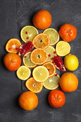 Whole and sliced citrus fruits
