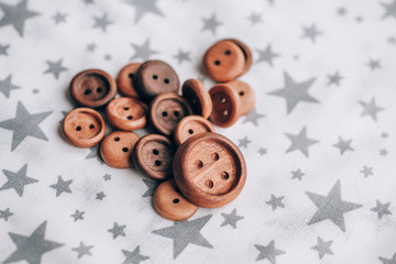 handmade wooden buttons on beautiful cotton fabric