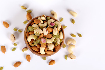 ssorted nuts on white, dry fruits, mix nuts, almond, cashew, pistachio, raisin