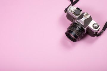 Vintage Camera on pink background,Travel concept