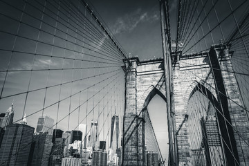 The Brooklyn Bridge in black and white with the new World Trade Center in the background, New York City, USA