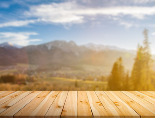 Raw pine planks on bokeh background