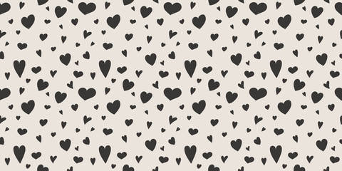 Design of a texture with cute hand drawn hearts. Valentine's Day, Mother's Day and Women's Day. Vector