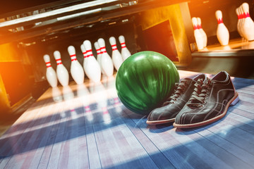 bowling. alley, ball, pins and shoes