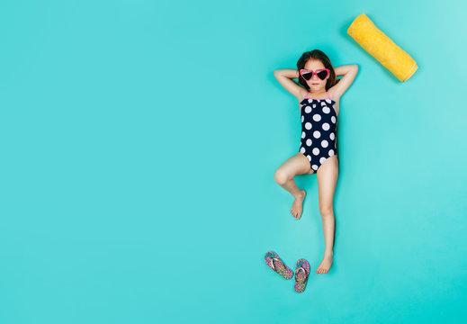 Cute girl imagining sunbathing on vacation