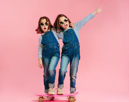 Stylish cute girls with skateboard