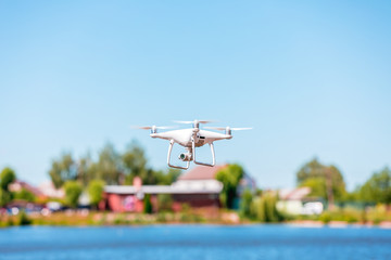 Drone copter with digital camera, blur river on background