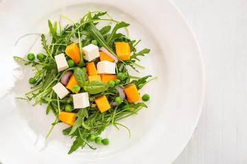 Fresh vegetable salad on plate, closeup. Diet food
