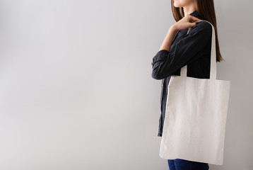 Woman with blank bag for branding on white background