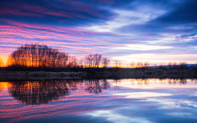 Stunning sunset with reflections on a lake
