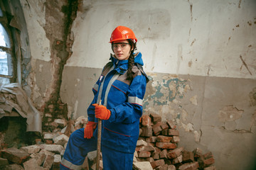 Destroying gender stereotypes. Woman wearing helmet using different male work tools. Gender equality. Girl working at flat remodeling. Building, repair and renovation. woman in the male profession
