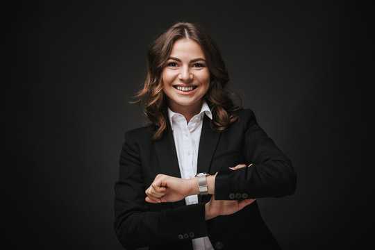 Confident young businesswoman wearing a suit standing