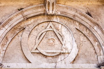 Conspiracy theory concept of Illuminati triangle and All Seeing Eye on an ancient temple