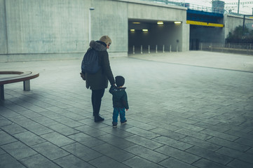 Toddler and grandmother walking in the city