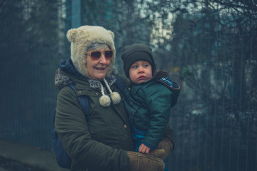 Toddler and grandmother outdoors in winter