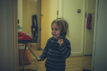 Little toddler talking on the phone