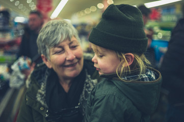Toddler and grandmother in supermarket