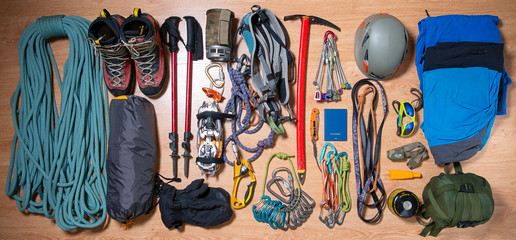 .climbing equipment on a wooden background before travel