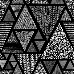 Black and white doodle style pattern. Patchwork ornament drawn by hand. Set of triangles. Vector illustration.