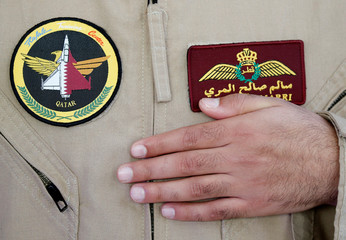 Military patches are worn by a Qatari Rafale jet fighter pilot during a ceremony at the factory of French aircraft manufacturer Dassault Aviation in Merignac