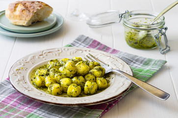 Portion of gnocchi with 'Pesto' sauce on wooden table