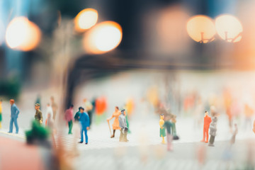 miniature people walking on streets,people are moving across the pedestrian crosswalk in the city road
