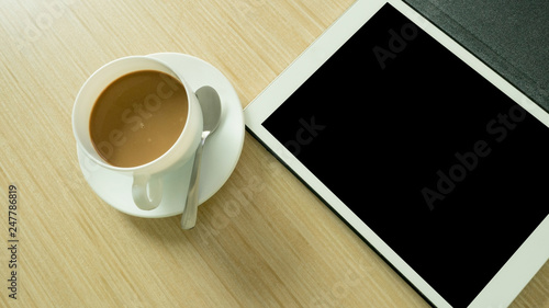Wall mural Office desk table  with taplet and coffee