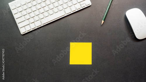 Wall mural workspace desk with keyboard and post it  copy space background black