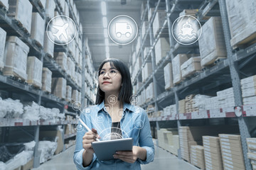 Portrait of young attractive asian entrepreneur woman looking at inventory in warehouse with smart tablet in management technology,  international connected industry, asian small business sme concept.