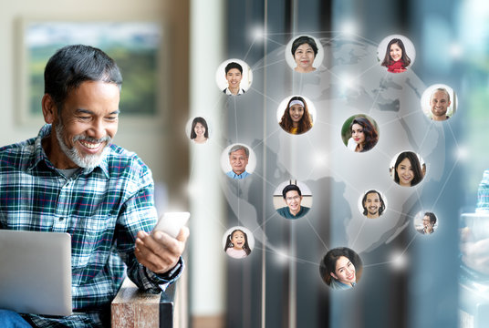 Social media network,  Global network connection and people connecting all over the world map. Smiling happy mature man using smartphone serving internet connect other person and play social media app